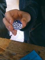 A happy badge maker kid...