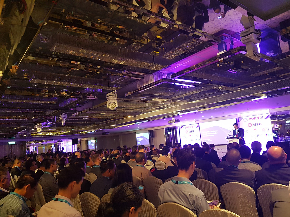 Below: Dr. Vincent Ho, IOSH President opens APOSHO 33 at the Regal Kowloon Hotel, Hong Kong