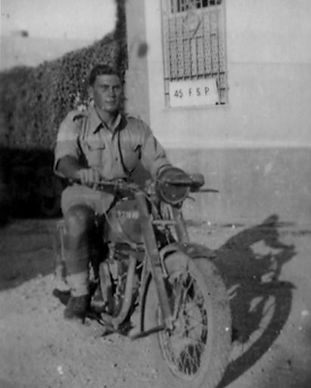 arthur-britton-on-motorcyle-with-contras