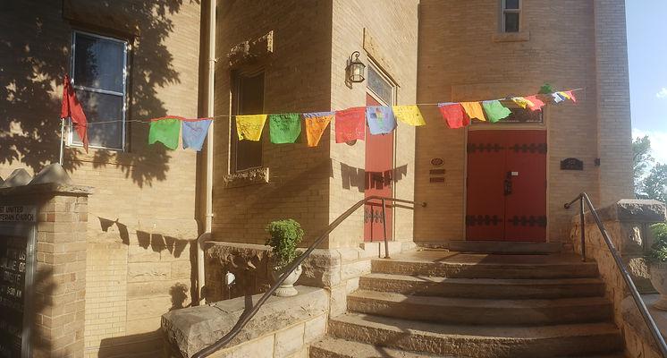 Prayer flags outside church original.jpg