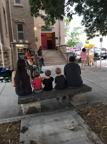 Family listening to music outside church