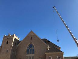 Crane hoisting the bell