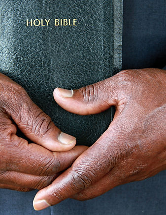 black man holding the Holy Bible after p