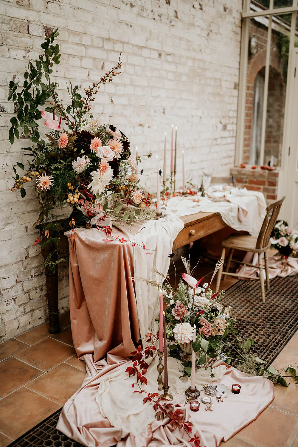 Styled wedding breakfast table with muted autumnal colours