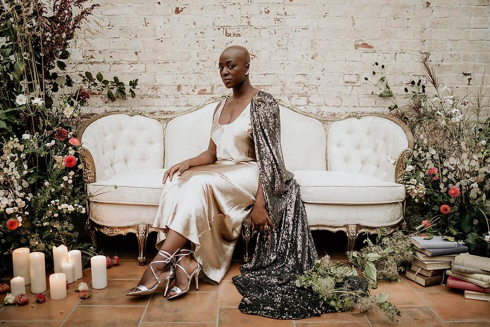 Bride sat down wearing a sequin cape
