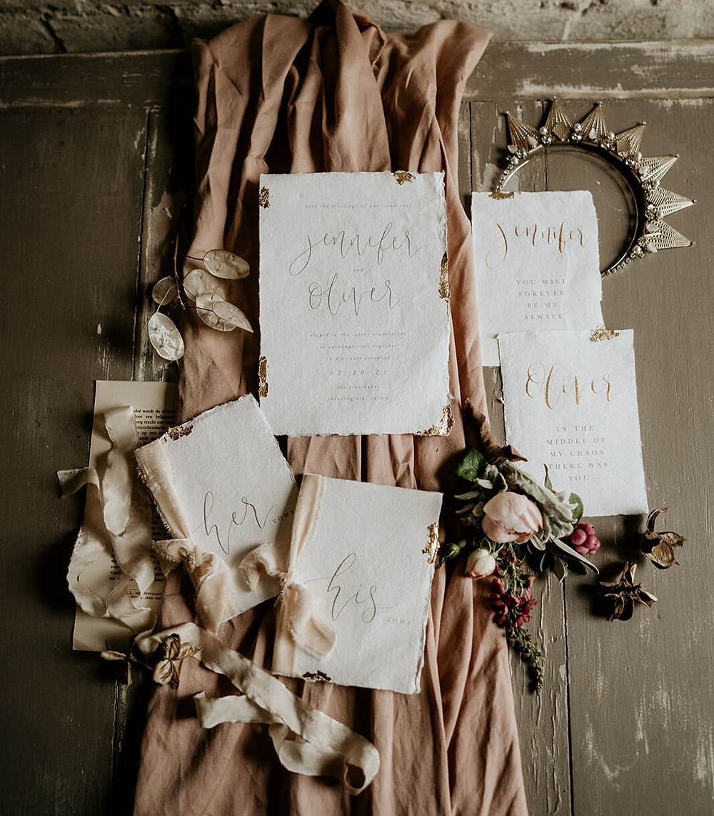 Wedding stationery with gold modern calligraphy, deckle edges and gold leaf