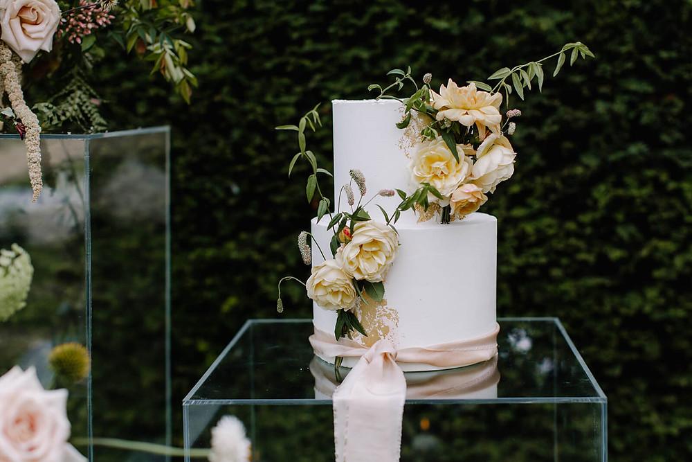 Buttercream wedding cake with seasonal flowers