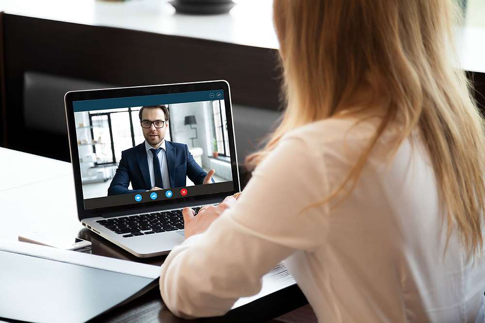 Woman and man on video call on laptop