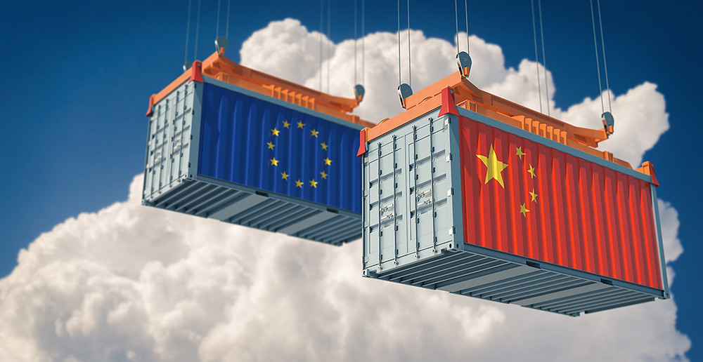 Two shipping containers, one displaying the flag of China and the other the flag of the European Union
