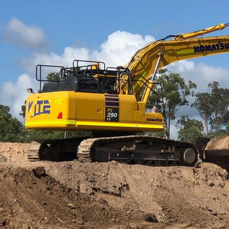 Loading top soil on a housing block in Carvers Reach, Park Ridge QLD 4125