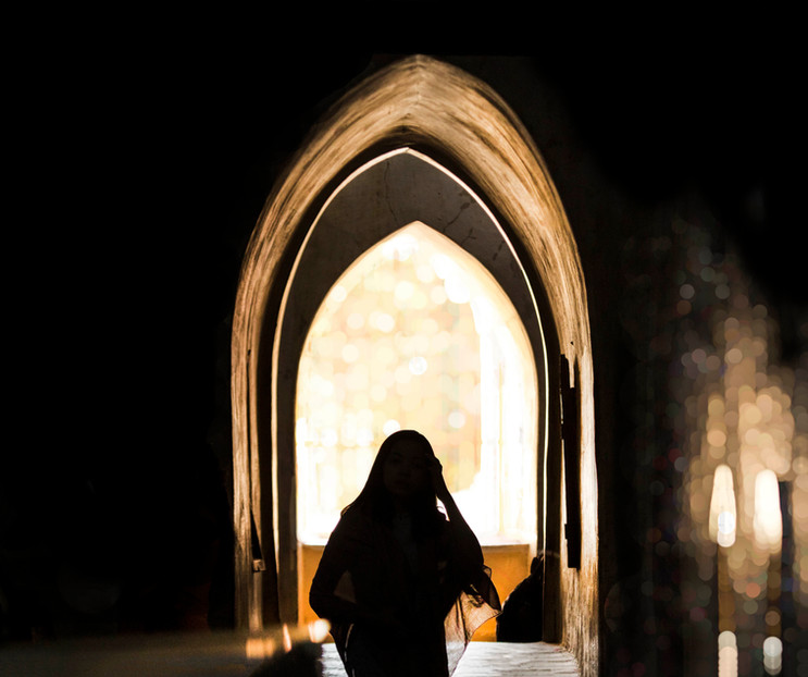 A woman glances through a window, Ananda temple, Bagan