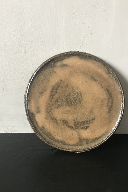 Large black clay plate