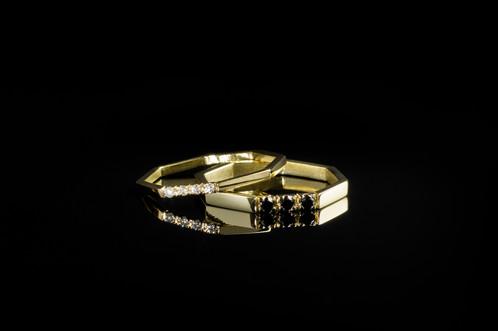 2x 14 karat goldrings 1x with 4x 001 carat twvs1 diamonds 780width 16 mm 1x with 3x 003 black diamonds 990 width 3mm together