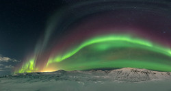 Snowy mountain Northern Lights