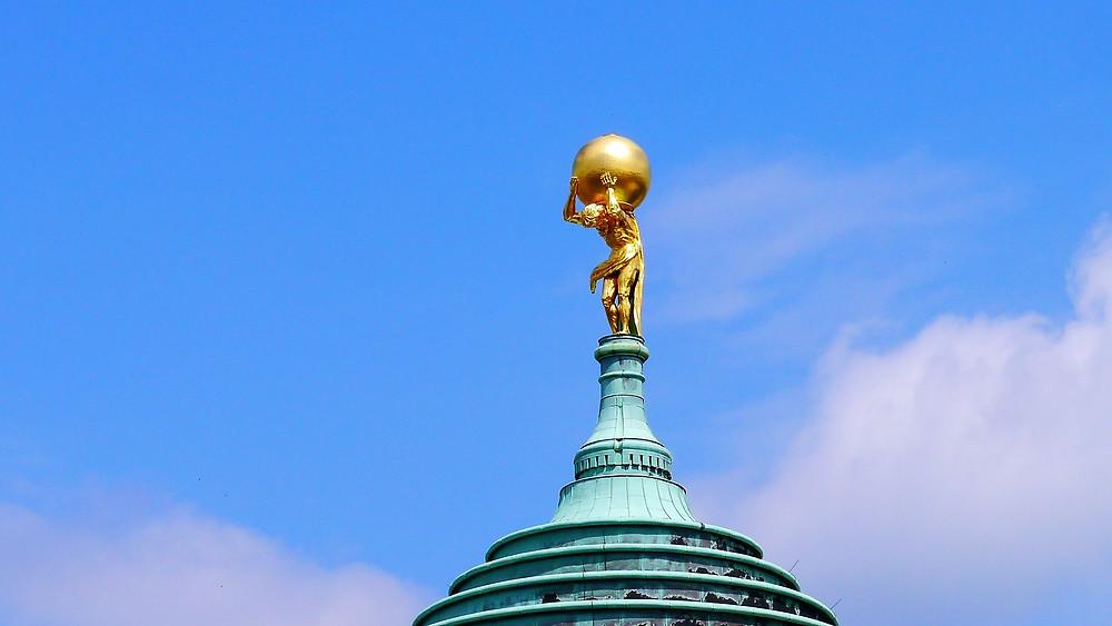 golden statue of Atlas