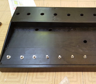 Next ridiculous tiered pedalboard with built-in looper, sprayed black