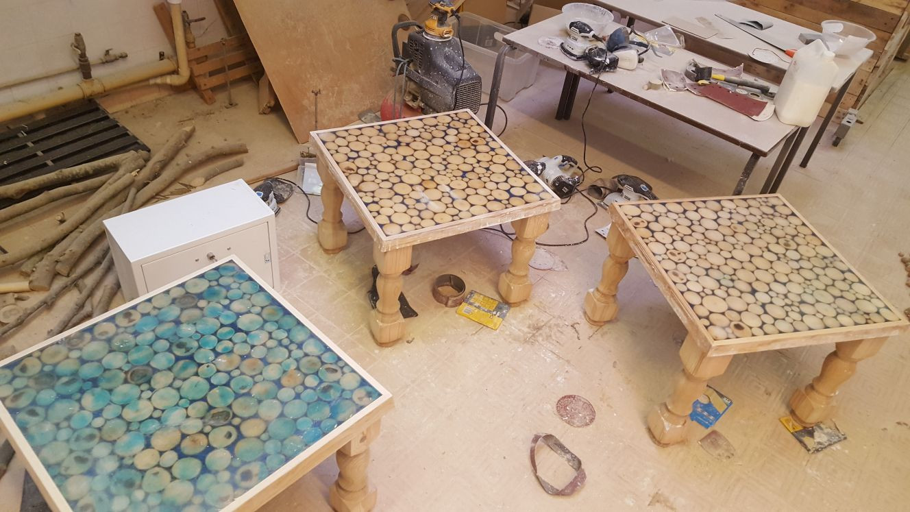 Tables at various stages. We bought so many sanders trying to work out how to do this best, it became a running joke. We ended up with a box full, around 8 in the end. Resin it turns out is not something you want to skim 3mm off the top of