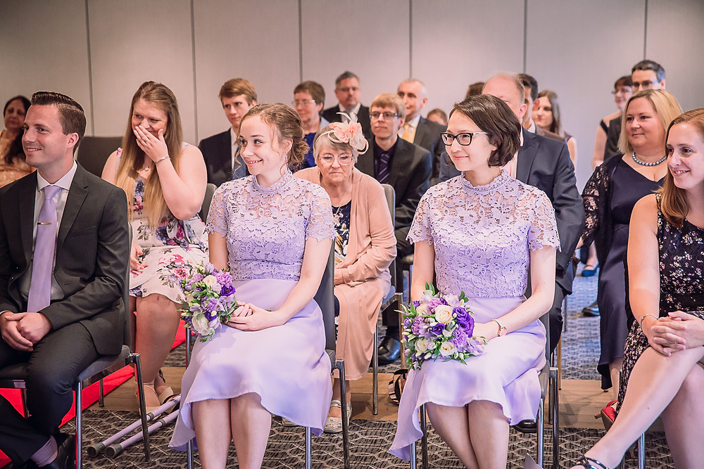 The bridesmaids look happy as the couple get married