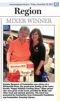 Laura Kurella gives away a KitchenAid to a lucky audience member