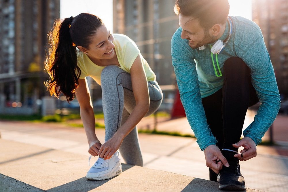 Man and woman prepare to exercise