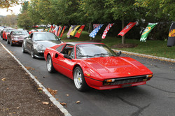 Driven By Purpose - Ferrari 308 leads out of the parking lot The Park Avenue Clu