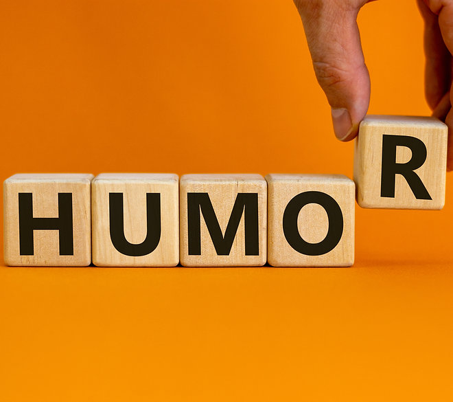 Humor symbol. Wooden cubes with word 'hu