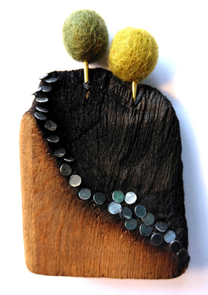 Wood, metal and textiles.