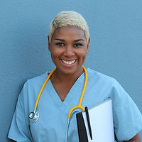 Canva - Afro american nurse standing at