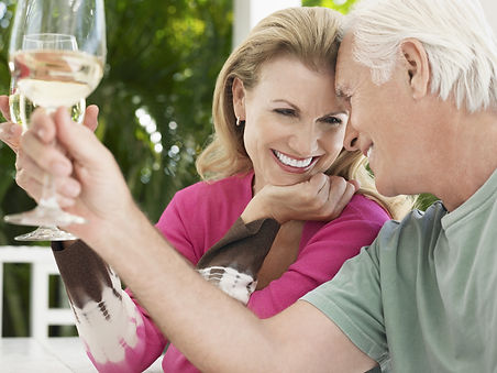 Cheerful middle aged couple toasting win