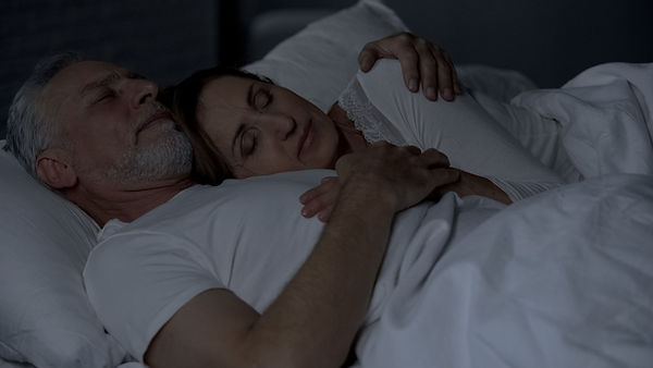 Senior woman lying on male chest, couple