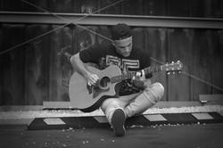 Dustin Tavella playing guitar