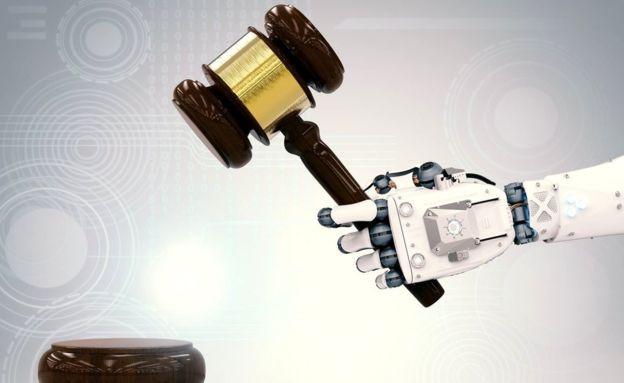 Robot arm banging gavel