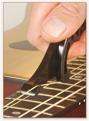 """The ultimate string stretching tool, STRING STRETCHA saves time and agony; in less than 5 pain-free minutes, it evenly slides up and down the strings giving each one a proper stretch to help keep your guitar stay perfectly tuned.  A lot of musicians mistake their guitar tuning problems as a guitar problem. More often than not, the guitar is not the problem. Tuning problems are likely the result of strings that have not been stretched properly.  When you stretch your strings using the conventional method of pulling on random areas of the string with your fingers, it causes an uneven stretch. Even using the """"thumb and fingers"""" method is problematic because it hurts and takes at least 45 minutes.  STRETCHA saves time and agony; taking only 5 minutes, pain-free, sliding up and down the strings evenly giving each string a proper stretch and allowing your guitar to be perfectly tuned instantly. This results in a better sounding guitar, as the strings will ring precisely and consistently with each strum.  Battlefield-tested in studios and by the world's most notable guitar tech pros, we are proud to say that STRETCHA has passed with flying colors."""