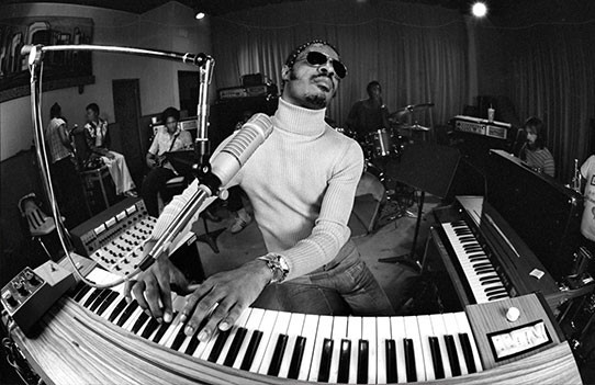 """Hohner persevered, and the Clavinet began to get a visible foothold in contemporary music with Jerry Goldsmith's 1967 score for the spy spoof movie """"In Like Flint"""" and Stevie Wonder's 1968 """"Shoo Be Doo Be Doo Da Day"""". A few years later, Wonder thrust the Clavinet fully into the spotlight on the mother of all funky keyboard songs, """"Superstition"""", on which he actually layered eight Clavinet tracks! Other notable examples of the instrument's full-on funk, pop and R&B driving power include Edgar Winter's """"Free Ride"""", Zep's """"Trampled Under Foot"""", and Max Middleton's work on Jeff Beck's """"Blow by Blow"""" LP. It also proved invaluable as the perfect energetic addition to electric guitar and bass in the left hand of rock songs like Fleetwood Mac's """"You Make Loving Fun"""" and The Eagles' """"Life in the Fast Lane""""."""