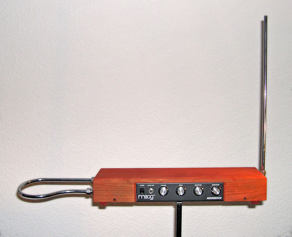 Assembled from a theremin kit: the loop antenna on the left controls the volume while the upright antenna controls the pitch.