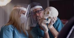 Dentist explaining the bones to the Associate Dentist