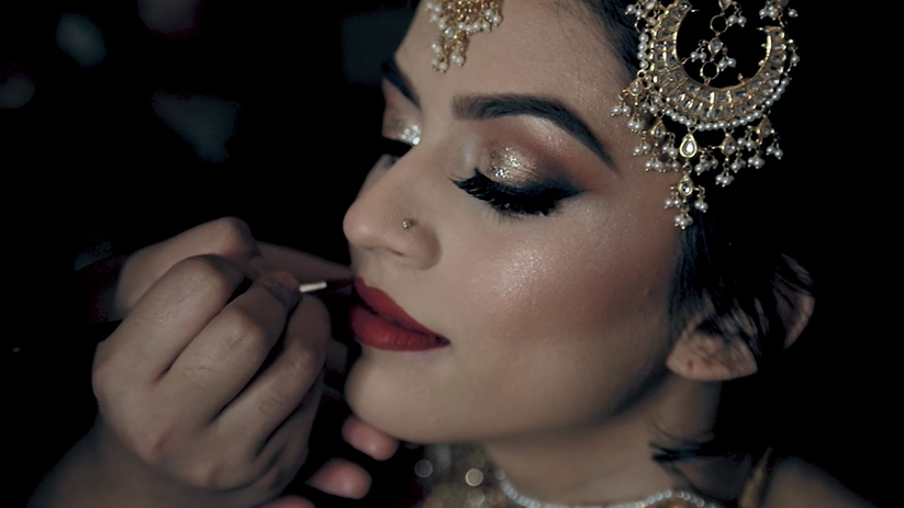Annaa having her makeup done during her Shaadi night at Eldorado Country Club in McKinney, Texas.