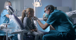 Pediatric dentist looking to the kid's tooth