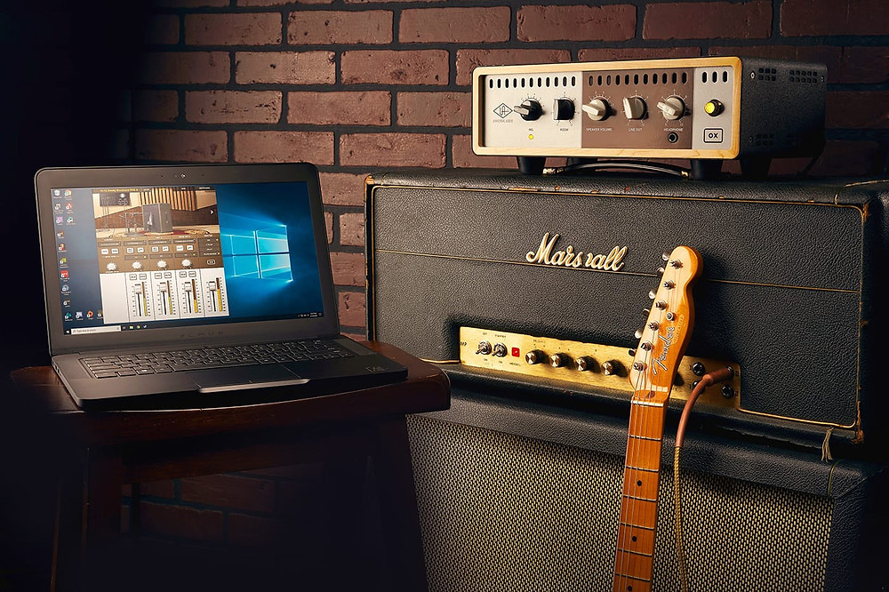 Universal Audio Announces OX Amp Top Box Windows 10 Compatibility Laptop on Side.