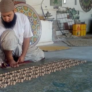 Pottenbakker_in_Fès rondreis Marokko Saffraan Reizen .jpg