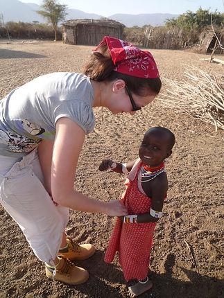 Little Masai Girl and Woman Traveler