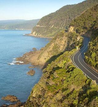road-winding-along-cliffs-on-great-ocean
