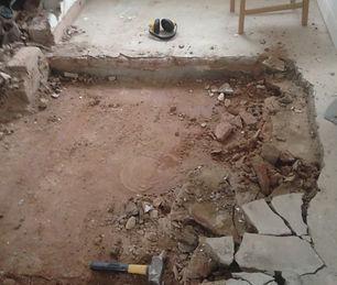 digging up floor.JPG
