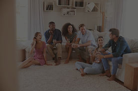group-of-friends-relaxing-at-home-and-dr