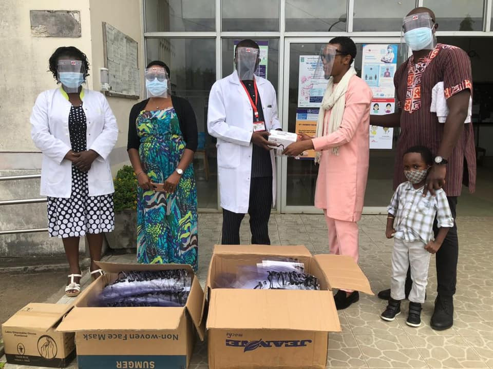 Members of I Am Cameroon present PPE to local healthcare workers.