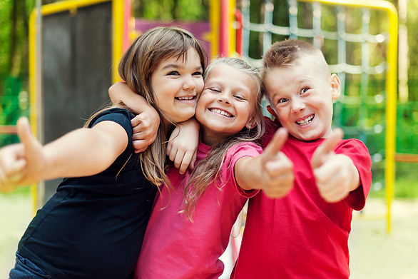 happy-children-showing-ok-sign-on-playground.jpg