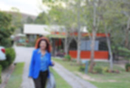 Cida Gomes,the restaurant's owner, standing in the garden