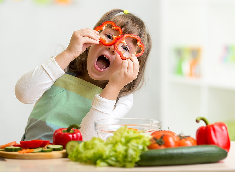 Winter wellness tip 6: Use food as nutrition, a child eating fresh vegetables_proper nutrition helps boost the immune system