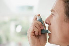 Man with an inhaler representing a primary care patient