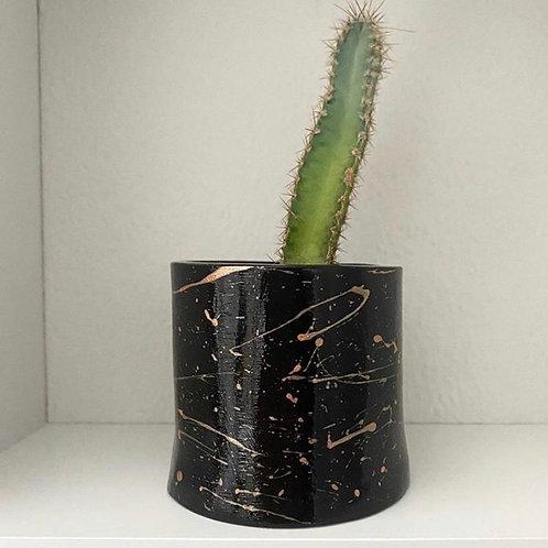 Black planter with rose gold splatter